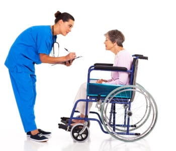 nurse checking her patient's condition